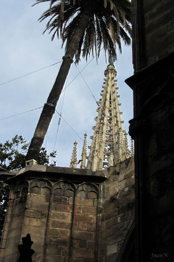 Image of Font de Santa Eulàlia. barcelona sky detail building architecture fence spain shadows palm spire thecloister barcelonacathedral cosmostour tourtoeuropeinseptnov2012