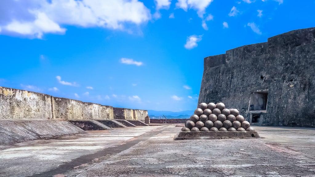 Image of Castillo San Cristóbal near San Juan. stockpile cannon cannonball ball vanishing point historic fort fortification castle san juan spanish puerto rico clouds sky ston grey blue castillo angle
