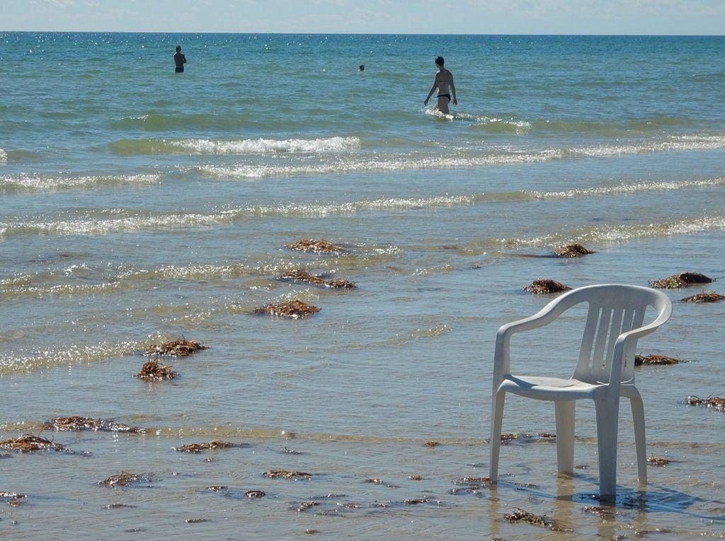 Image of Grange Beach near Grange. grange beach shore chair empty context edge