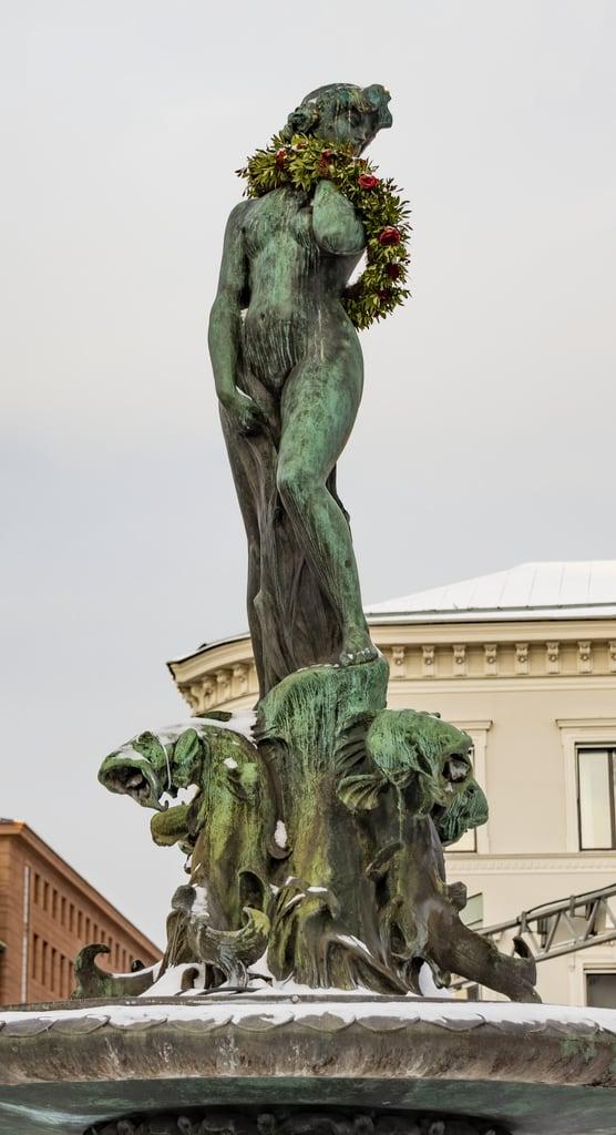 Image of Havis Amanda. mermaid statue finland helsinki snow ice fountain christmas wreath havis amanda