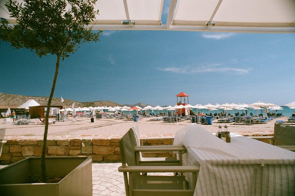 Image of Varkiza Beach (Παραλία Βάρκιζας) Beach of Varkiza near Vári. sea sun holiday tree film beach table sand chairs superia athens greece umbrellas 2010 lifeguardtower nikonf80 fujisuperia vari vouliagmeni varibeach fb:uploaded=true fb:request=true nikkor20mmf28afd vouliagmenibeach athensbeach
